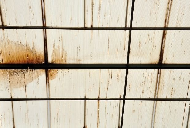 Dark Stains And Streaks on a roof is a sign to change the roof